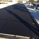 Solar pool panels placed on a metal rack