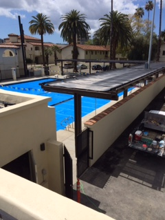 Solar Panels heating a community pool